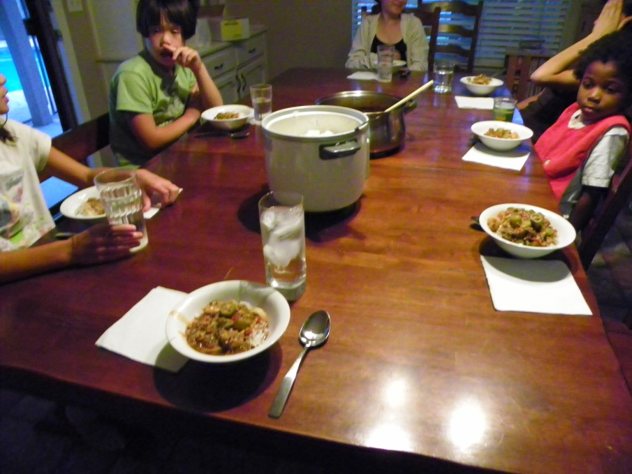 Here's my family gathered around the table to enjoy some homemade gumbo.