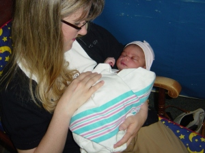 Here I am the first time I met my gorgeous baby Charlotte, the day after her birth.